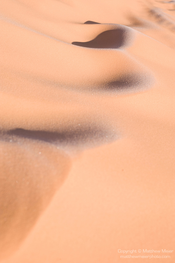 Coral Pink Sand Dunes State Park, Kanab, Utah; patterns caused by old foot prints in the sand dunes in early morning light with frost still visible from the overnight freeze in winter