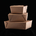 Three folded recyclable cardboard containers for takeout foods, empty, stacked