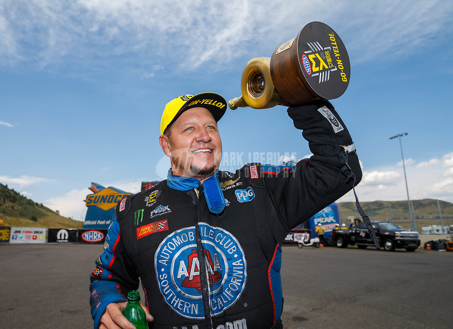 Jul 23, 2017; Morrison, CO, USA; NHRA funny car driver Robert Hight celebrates after winning the Mile High Nationals at Bandimere Speedway. Mandatory Credit: Mark J. Rebilas-USA TODAY Sports
