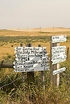 Ranch milage and direction signs at crossroads in rural Montana.