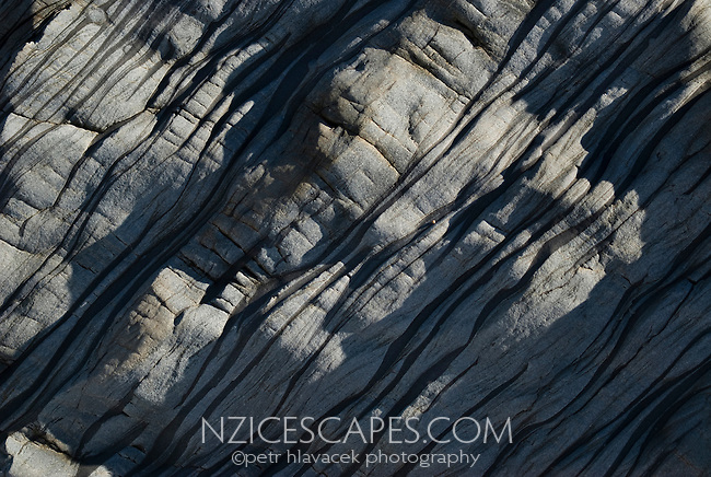 A detail of the eroded limestone rock on the West Coast beach.