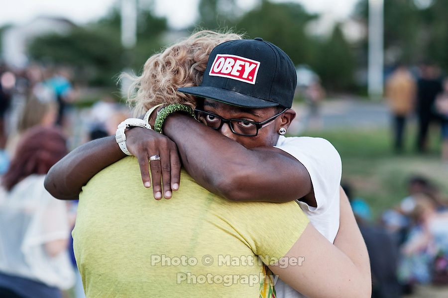 Brenden Matthews (cq), 18, and Kiara Leggitt (cq), 18, during a vigil held next to the Aurora Century 16 movie theater where James Holmes (cq), 24, is in custody and is suspected of killing 12 people and wounding many more in Aurora, Colorado, Friday, July 20, 2012. The shootings occurred during the midnight premiere of the new Dark Knight Batman movie...Photo by MATT NAGER