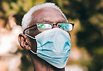 Sudanese man sits next to his wife wearing a mask, as a precaution against the spread of the coronavirus disease (COVID-19) in Khartoum, Sudan on May 05, 2020. Photo by faiz Abu bakr
