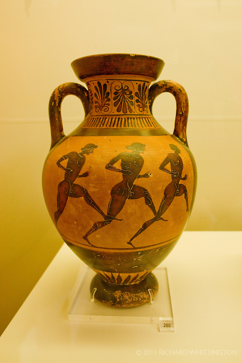 This amphora from the Olympia Archaeological Museum depicts Greek men running in the Olympic Games.