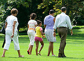 Washington, D.C. - August 1, 2009 -- United States President Barack Obama and his family depart the South Lawn of the White House en route to Camp David on Saturday, August 1, 2009.  From left to right: Marian Robinson, mother-in-law; Malia Obama; Sasha Obama; first lady Michelle Obama; and President Obama..Credit: Ron Sachs / Pool via CNP