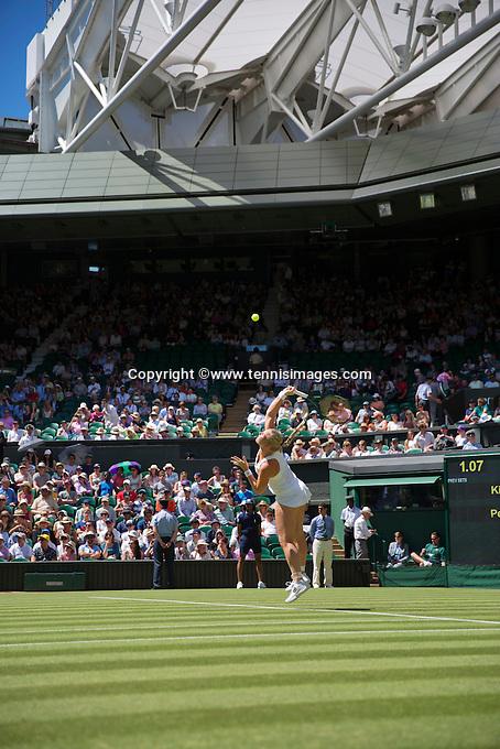 England, London, June 30, 2015, Tennis, Wimbledon, Kiki Bertens (NED) serving on Centercourt<br /> Photo: Tennisimages/Henk Koster