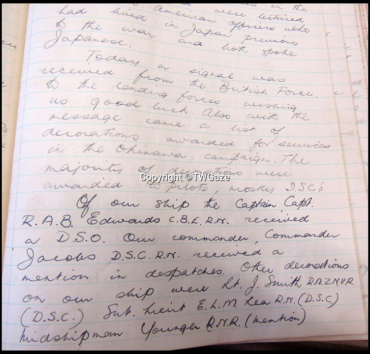 BNPS.co.uk (01202 558833)<br /> Pic: TWGaze/BNPS<br /> <br /> Pikes account of awards for the Gambia's role in the Okinawa battle.<br /> <br /> A Royal Navy officer's secret log has emerged to expose a potential cover up over the deaths of five seamen who were apparently killed in the final salvos of World War Two.<br /> <br /> Midshipman John Pike wrote of how at the very moment the order to cease fire against Japan on August 15, 1945 came through his ship came under attack by a lone kamikaze aircraft.<br /> <br /> The dive bomber fired its machine guns at the quarterdeck of HMS Gambia, prompting the crew to scatter and the ship to fire its guns in retaliation.<br /> <br /> Moments later two American Corsair fighter planes arrived and shot the enemy plane out of the sky. <br /> <br /> With the danger cleared the crew of the navy cruiser gathered themselves and realised that five men had been killed by the machine gun fire.