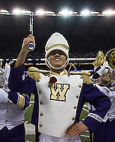 Senior drum major Brian Huynh performs at the end of his final half time show.