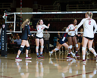 STANFORD, CA - December 1, 2018: Meghan McClure, Morgan Hentz, Tami Alade, Kathryn Plummer at Maples Pavilion. The Stanford Cardinal defeated Loyola Marymount 25-20, 25-15, 25-17 in the second round of the NCAA tournament.
