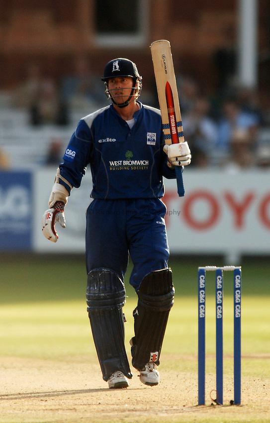 Photo: Glyn Thomas..Hampshire v Warwickshire. C&G Trophy Final..03/09/2005..Warwickshire's Nick Knight celebrates reaching his century.