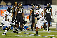 30 March 2012:  FIU's Loranzo Hammonds (8) makes his way through the secondary while carrying the ball for a touchdown that was called back due to a penalty at the FIU Football Spring Game at University Park Stadium in Miami, Florida.
