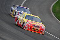 Oct. 11, 2009; Fontana, CA, USA; NASCAR Sprint Cup Series driver Marcos Ambrose leads David Reutimann during the Pepsi 500 at Auto Club Speedway. Mandatory Credit: Mark J. Rebilas-