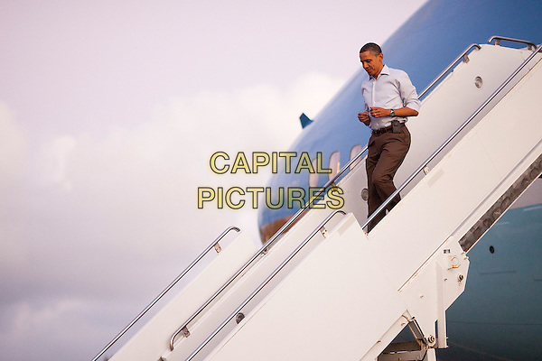 United States President Barack Obama disembarks from Air Force One at Joint Base Pearl Harbor-Hickam in Honolulu, Hawaii, Friday, December 23, 2010. President Obama joins First Lady Michele Obama and daughters Sasha and Malia in Hawaii for the winter holidays. .CAP/ADM/CNP/Pool/KN.©Kent Nishimura/Pool/CNP/AdMedia/CapitalPictures.