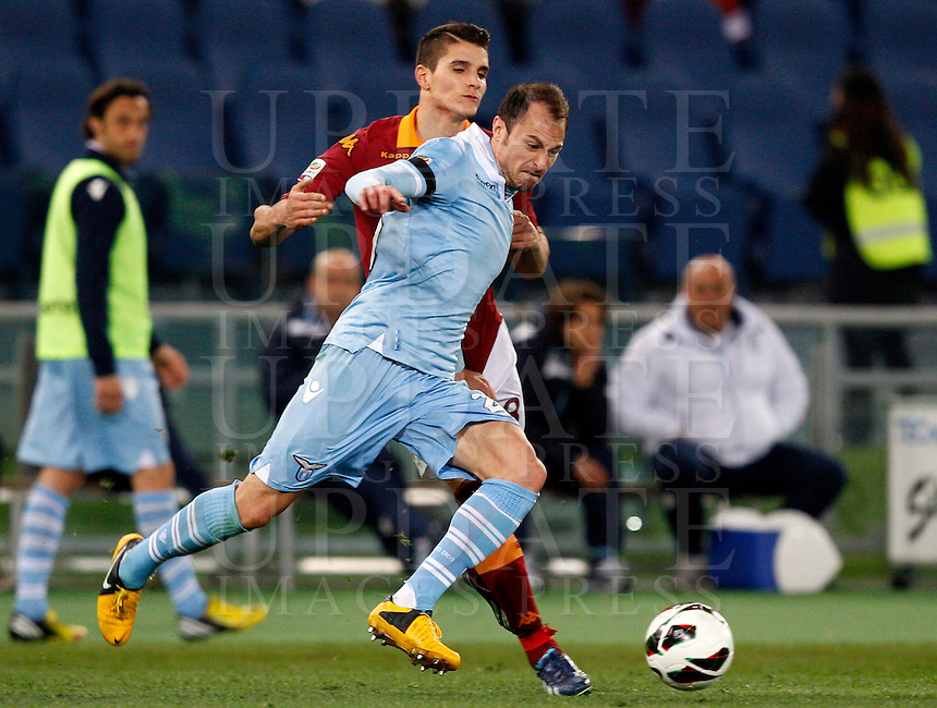 Calcio, Serie A: Roma vs Lazio. Roma, stadio Olimpico, 8 aprile 2013..Lazio defender Stefan Radu, of Romania, foreground, is challenged by AS Roma forward Erik Lamela, of Argentina, during the Italian Serie A football match between AS Roma and Lazio at Rome's Olympic stadium, 8 April 2013..UPDATE IMAGES PRESS/Riccardo De Luca