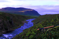 Atlantic Salmon Catch and Release Fly Fishing in Iceland. Scenic view from the mountain section of Svalbardsa in Thistilfjordur with fly rod in the foreground.