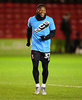Lincoln City's Tayo Edun during the pre-match warm-up<br /> <br /> Photographer Andrew Vaughan/CameraSport<br /> <br /> The EFL Sky Bet League One - Lincoln City v Milton Keynes Dons - Tuesday 11th February 2020 - LNER Stadium - Lincoln<br /> <br /> World Copyright © 2020 CameraSport. All rights reserved. 43 Linden Ave. Countesthorpe. Leicester. England. LE8 5PG - Tel: +44 (0) 116 277 4147 - admin@camerasport.com - www.camerasport.com