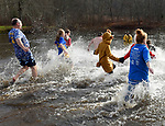 People run into the icy cold water during the ninth annual Vernon Parks and Recreation Department Polar Plunge, Saturday, December 2, 2017, in Vernon. (Jim Michaud / Journal Inquirer)