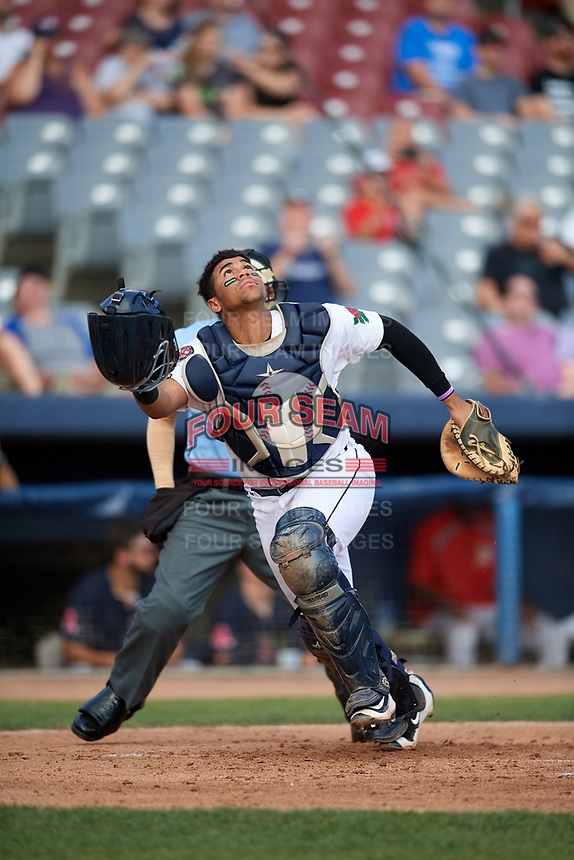 Connecticut Tigers catcher Moises Nunez (20) tracks a pop up in front of home plate umpire David Cruz during a game against the Lowell Spinners on August 26, 2018 at Dodd Stadium in Norwich, Connecticut.  Connecticut defeated Lowell 11-3.  (Mike Janes/Four Seam Images)