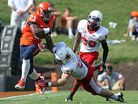 Virginia running back Khalek Shepherd (23) is tackled by Ball State linebacker Trent Toothman (50) during the football game Saturday Oct. 5, 2013 at Scott Stadium in Charlottesville, VA. Ball State defeated Virginia 48-27. Photo/The Daily Progress/Andrew Shurtleff