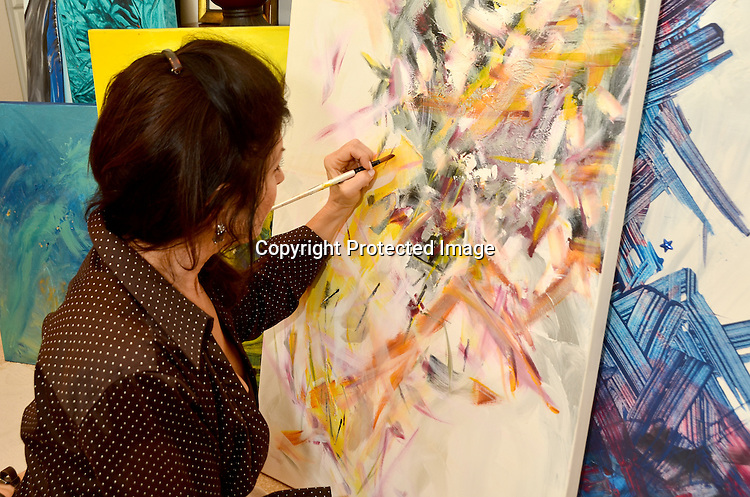 Woman artist working on painting