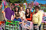 TOYS: On their way home after shopping in Castlegregory on Pattern Day were children and their mother to their home in Castlegregory, L-r: Robbie Goodwin, Jimmy Maunsell, Fiedelmaand Ashley Maunsell, Ciara and Ann Goodwin...