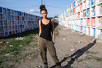 UK celebrity Myleene Klass poses for a portrait in a tomb aisle as she waits to meet underprivileged mothers and children in an inhabited cemetery in Paranaque City, Metro Manila, The Philippines on 18 January 2013. Photo by Suzanne Lee for Save the Children UK
