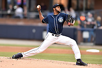 Asheville Tourists starting pitcher Antonio Santos (10) delivers a pitch during a game against the Kannapolis Intimidators at McCormick Field on April 18, 2017 in Asheville, North Carolina. The Intimidators defeated the Tourists 6-1. (Tony Farlow/Four Seam Images)