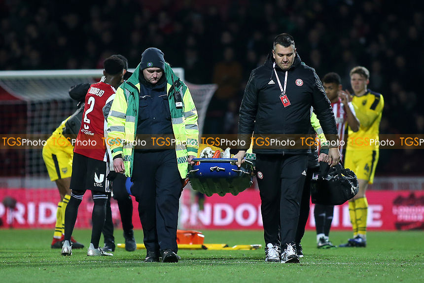 Shandon Baptiste of Oxford United is carried off on a stretcher after suffering an injury during Brentford vs Oxford United, Emirates FA Cup Football at Griffin Park on 5th January 2019