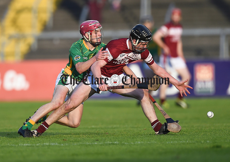 Diarmuid O Brien of Broadford in action against Kevin Meaney of St Joseph's Doora Barefield during their Intermediate county final in Cusack Park. Photograph by John Kelly.