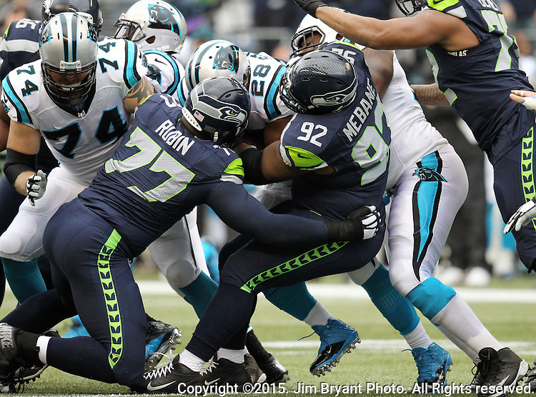 Seattle Seahawks  defensive tackles Ahyta Rubin (77) and Brandon Mebane (92) team ip to bring down Carolina Panthers ' running back Jonathan Stewart (28) at CenturyLink Field in Seattle on October 18, 2015. The Panthers came from behind with 32 seconds remaining in the 4th Quarter to beat the Seahawks 27-23.  ©2015 Jim Bryant Photography. All Rights Reserved.