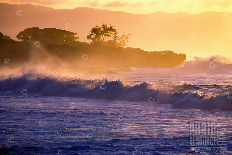 Waves breaking on the North Shore looking west towards the Waianae Mountain range