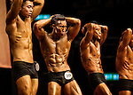 A bodybuilder competes in the Men's Athletic Physique over 170cm + 4kg category during the 2016 Hong Kong Bodybuilding Championships on 12 June 2016 at Queen Elizabeth Stadium, Hong Kong, China.  Photo by Victor Fraile / Power Sport Images