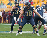 Pitt offensive lineman Alex Bookser (78) blocks for quarterback Ben DiNucci. The Pitt Panthers defeated the Virginia Cavaliers 31-14 at Heinz Field, Pittsburgh, PA on October 28, 2017.