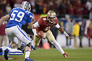 December 7, 2013  (Charlotte, North Carolina)  Florida State Seminoles quarterback Jameis Winston #5 tries to avoid the tackle of Duke Blue Devils linebacker Kelby Brown #59 during the 2013 ACC Championship game. FSU defeated Duke 45-7. (Photo by Don Baxter/Media Images International)