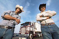Kansas City, Missouri, September 9, 1978. Moment of rest at the Truck Stop. Ralph Hill with the black hut, 34 years old and his partner Daniel Gibson, 29 years old, with white cowboy hut. They dream to save enough money to have their own truck one day.