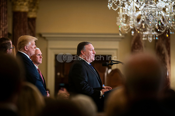 Mike Pompeo, U.S. secretary of state, speaks beside U.S. President Donald Trump, and Vice President Mike Pence, after being sworn in, at the State Department, in Washington, D.C., U.S., on Wednesday, May 2, 2018. <br /> Credit: Al Drago / Pool via CNP /MediaPunch