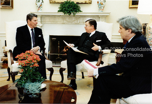 United States President Ronald Reagan, left, meets with U.S. Senators John Tower (Republican of Texas), center, and John Warner (Republican of Virginia), right, in the Oval Office of the White House in Washington, D.C. on Tuesday, January 10, 1984..Mandatory Credit: Pete Souza - White House via CNP