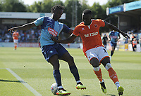 Blackpool's Joe Dodoo vies for possession with Wycombe Wanderers' Anthony Stewart<br /> <br /> Photographer Kevin Barnes/CameraSport<br /> <br /> The EFL Sky Bet League One - Wycombe Wanderers v Blackpool - Saturday 4th August 2018 - Adams Park - Wycombe<br /> <br /> World Copyright &copy; 2018 CameraSport. All rights reserved. 43 Linden Ave. Countesthorpe. Leicester. England. LE8 5PG - Tel: +44 (0) 116 277 4147 - admin@camerasport.com - www.camerasport.com