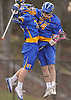 Conor Smith #24 of West Islip, right, gets congratulated by teammate CJ Scharf #33 after scoring the game-tying goal against Northport with 46 remaining in a Suffolk County varsity boys lacrosse game at Veterans Park in East Northport on Monday, Apr. 18, 2016. Smith struck again to break the tie with 18 seconds remaining and tallied five goals in total to lead West Islip to a 10-9 victory.
