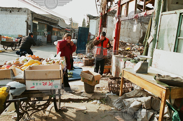 A fruit seller's stall in one of the few remaining Hutongs near Qianmen Dongdaje. These old neighboorhoods are dissappearing fast as they are destroyed to make room for high rise buildings.