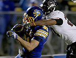 BROOKINGS, SD - OCTOBER 11:  Zach Zenner #31 from South Dakota State is tackled around the head by Mike Crutcher #20 from Missouri State in the fourth quarter Saturday evening at Coughlin Alumni Stadium in Brookings. (Photo/Dave Eggen/Inertia)