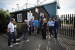 Club chairman Paul Leary watching on as supporters arrive at the Mersey Travel Arena, home to Marine Football Club, pictured before they played host to Ilkeston FC in a Northern Premier League premier division match. The match was won by the home side by 3 goals to 1 and was watched by a crowd of 398. Marine are baed in Crosby, Merseyside and have played at Rossett Park (now the Mersey Travel Arena)  since 1903, the club having been formed in 1894.