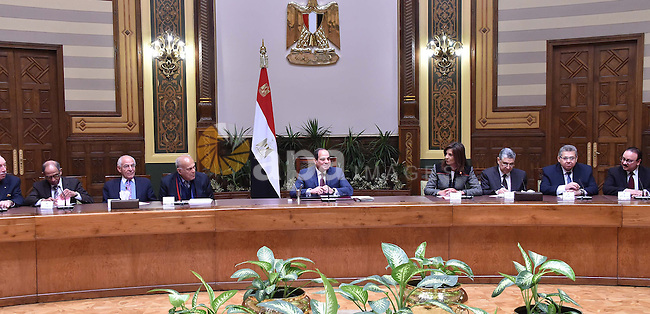 Egyptian President Abdel Fattah al-Sisi, meets with the delegation from Egypt Scholars Abroad, in Cairo, Egypt, on December 17, 2016. Photo by Egyptian President Office