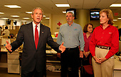 Washington, D.C. - September 4, 2005 -- United States President George W. Bush makes a plea for donations during a visit to the American Red Cross Command Center in Washington, D.C., September 4, 2005. At right are Red Cross President and CEO Marty Evans (red shirt) and Executive Vice President, Chapter and International Operations, Alan McCurry.<br /> Credit: Martin H. Simon - Pool via CNP