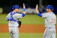St. Lucie Mets catcher Cam Maron #7 and pitcher Hamilton Bennett #21 high five after a game against the Bradenton Marauders on April 12, 2013 at McKechnie Field in Bradenton, Florida.  St. Lucie defeated Bradenton 6-5 in 12 innings.  (Mike Janes/Four Seam Images)