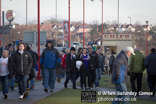Derby County 1 Nottingham Forest 2, 17/01/2015. iPro Stadium, Championship. Supporters walking towards the iPro Stadium before Derby Country's Championship match against Nottingham Forest. The match was won by the visitors by 2 goals to 1, watched by a derby-day crowd of 32,705. The stadium, opened in 1997, was formerly known as Pride Park. Photo by Colin McPherson.