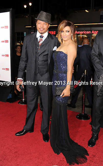 HOLLYWOOD, CA- NOVEMBER 05: Actors Terrence Howard (L) and Melissa De Sousa arrive at the Los Angeles premiere of 'The Best Man Holiday' at TCL Chinese Theatre on November 5, 2013 in Hollywood, California.