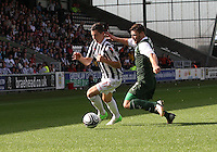 Kenny McLean tackled by Gary Deegan in the St Mirren v Hibernian Clydesdale Bank Scottish Premier League match played at St Mirren Park, Paisley on 18.8.12.