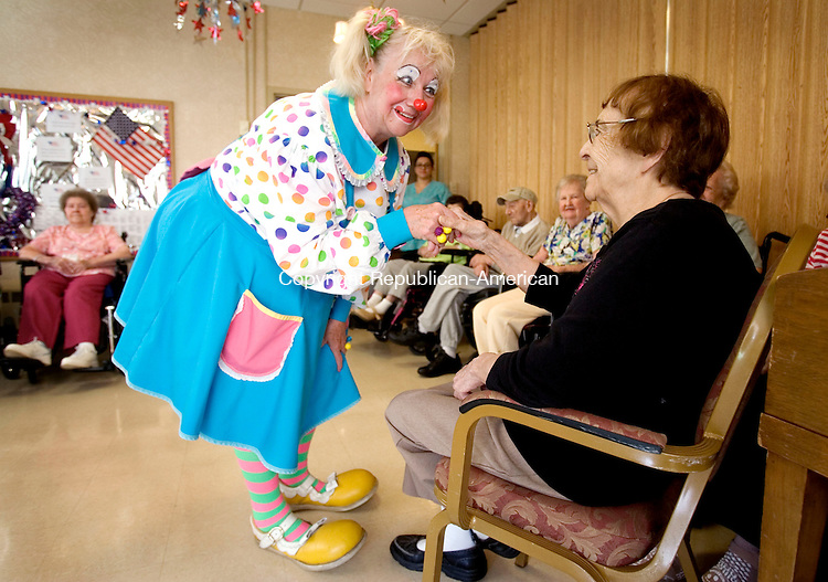 MIDDLEBURY CT. 17 June 2014-061714SV04-Blondi, Teresa Gretton, talks with Tina Perela at Middlebury Convalescent Home Rehabilitation Service in Middlebury Tuesday. Clowns Blondi and Bunky, goodwill ambassador for the Cole Bros., were at the convalescent home to cheer up resident. <br /> Steven Valenti Republican-American