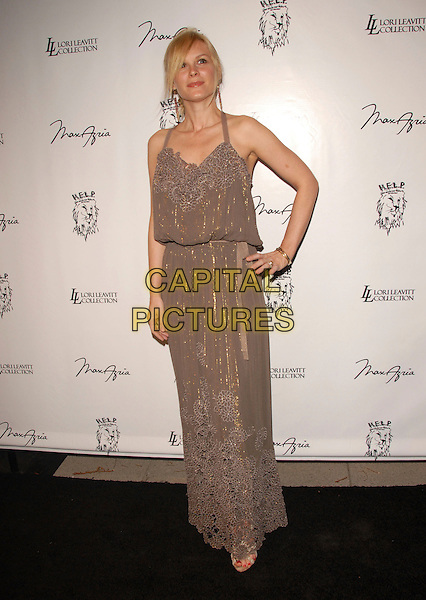 NIKKA COSTA .Attends The Launch Party for The Help Malawi Foundation held at Max Azria in Hollywood, California, USA..April 19th, 2007.full length brown beige dress gold pattern hand on hip .CAP/DVS.©Debbie VanStory/Capital Pictures